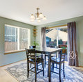 Nice dinning room with carpet and windows well put together sliding glass door window modern decor rug Stock Photos