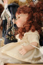 Nice doll brown curly hair Royalty Free Stock Photography