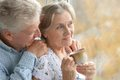 Nice elderly couple together at home near window Royalty Free Stock Photos