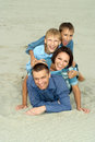 Nice family in blue lying Stock Photo