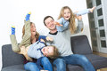 Nice family sit on the livingroom sofa Royalty Free Stock Photo