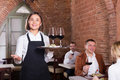 Nice female waiter showing country restaurant Royalty Free Stock Photo