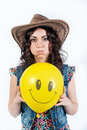 Nice funny girl with inflated cheeks and yellow balloon Royalty Free Stock Photography