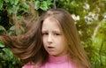 Nice  girl costs near a tree Royalty Free Stock Photo
