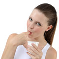 Nice girl eating yogurt sucking finger young Stock Image