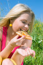 Nice girl eats pizza. lunch Royalty Free Stock Photo