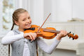 Nice girl playing the violin Royalty Free Stock Photo