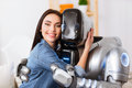 Nice girl and robot embracing Royalty Free Stock Photo