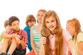 Nice girl searching with magnified glass and mates Royalty Free Stock Photo
