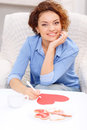 Nice girl sitting at the table Royalty Free Stock Photo
