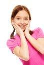 Nice happy exited smiling years old girl pintails hands her face expressing surprise isolated white Stock Photography