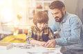 Nice intelligent boy doing a jigsaw puzzle with his father Royalty Free Stock Photo