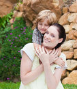 Nice kid embracing his mother Royalty Free Stock Images