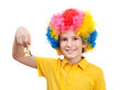 Nice kid wears colorful wig and calls by hand bell isolated on white background Stock Image