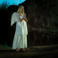 Nice lady posing like angel outdoor angels on earth with wings in nature by the lake Royalty Free Stock Photography