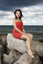 Nice lady posing on the rock by sea for portrait and fashion figure photos in caorle italy Stock Image