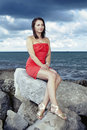 Nice lady posing on the rock by sea for portrait and fashion figure photos in caorle italy Stock Photos
