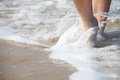 Nice legs in water pedicure red nail sand beach Royalty Free Stock Images