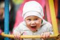 Nice little baby girl laughs on the swing Stock Photo