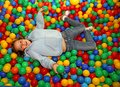 Nice little girl play dipped in colored balls of kindergarten po Royalty Free Stock Photo