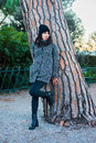 Nice looking girl posing next to a tree in the park Royalty Free Stock Photo
