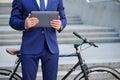 Nice man holding laptop near bicycle Royalty Free Stock Photo