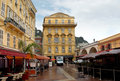 Nice old building in the cours saleya france april and a cafe on april france is a place of outdoor Stock Image