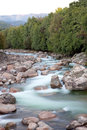 Nice river with clear water flowing between the rocks Royalty Free Stock Image