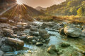 Nice river water flowing through rocks at dawn beautiful reshi on sikkim india sun rays the background falling on making Royalty Free Stock Images