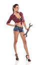 Nice sexy woman mechanic holding wrench Royalty Free Stock Photo