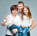 Nice smiling family looking camera Royalty Free Stock Images