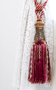 Nice tassel tied on the neat and finely curtain image Royalty Free Stock Photos