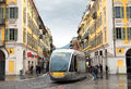 Nice tram in the center of city france april modern on april france people are walking along street Royalty Free Stock Image