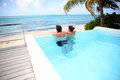 Nice view from the pool couple looking at sea swimming Royalty Free Stock Photo