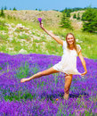 Nice woman dancing on lavender field Royalty Free Stock Photo