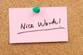Nice work words written on paper and pinned on corkboard Stock Photo