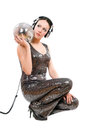Nice young brunette headphones mirror ball isolated white Royalty Free Stock Images