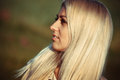 Nice young girl blond with long white hair looking into the distance Stock Photo
