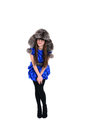 Nice young lady in fur hat with pompons Royalty Free Stock Photos