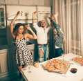 Nice young people dancing at pizza party celebrate disco nightlife entertainment friendship concept Stock Image