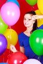 Nice young woman among many bright balloons Royalty Free Stock Photo