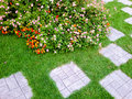 Nicely decorated garden with stones and plants home Royalty Free Stock Photo