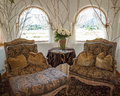 A nicely decorated sitting room with arched windows Royalty Free Stock Photos
