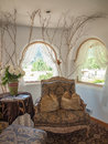 A nicely decorated sitting room with arched windows Royalty Free Stock Photography