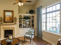 Nicely furnished den in window light new home with fireplace Stock Image