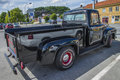 Nicely restored ford f pickup classic american car the photo is shot at the fish market in halden norway Royalty Free Stock Image