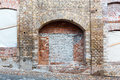 Niche on brickwall old weathered brick wall with arched Stock Photos