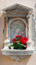 Niche with the holy virgin mary and red flowers Royalty Free Stock Photography