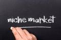 Niche market hand underline word on chalkboard Royalty Free Stock Image