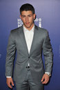 Nick jonas beverly hills ca august musician of the brothers at the hollywood foreign press association s annual grants Royalty Free Stock Photo